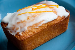 Lemon frosted almond cake Stock Photos