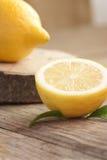 Lemon fruit. Organic  lemon fruit on nature wooden background Royalty Free Stock Photos