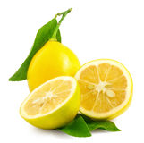 Lemon. Fruit with half and leaves isolated on white Royalty Free Stock Images