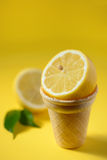 Lemon fruit in ice cream cone Royalty Free Stock Photo