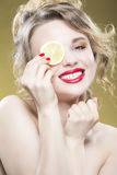 Lemon Fruit Series. Closeup Portrait of Sensual Naked Caucasian. Blond Girl Posing with Lemon Slice Against Yellow.Vertical Shot Stock Photos