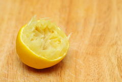 Lemon fruit squeezed on wooden table board background Stock Photo