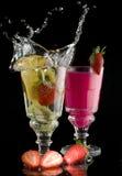 Lemon fruit   strawberry milk drink with a splash Royalty Free Stock Images