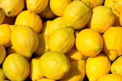 Lemon fruits in the marketplace Stock Images
