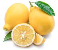 Lemon fruits and lemon slices on white background. Royalty Free Stock Photography