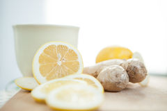 Lemon and ginger with cup on the table Royalty Free Stock Photography