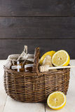 Lemon, ginger, honey in wattled basket on a wooden background.  Stock Photo
