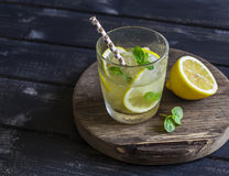 Lemon, ginger and mint lemonade on a wooden rustic board. Royalty Free Stock Photos