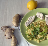 Lemon and ginger sauce chicken pasta with pieces of ginger and l Stock Image