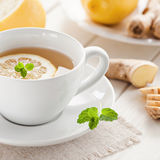 Lemon ginger tea. Cuo of tea with fresh lemon and ginger Royalty Free Stock Photography
