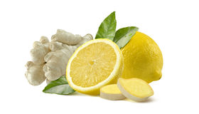Lemon and ginger  whole slices  on white background. Lemon and ginger whole slices composition  on white background as package design element Royalty Free Stock Photography