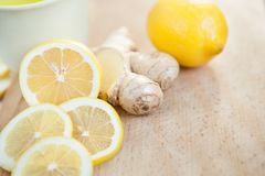 Lemon and ginger on the wooden background Stock Photos