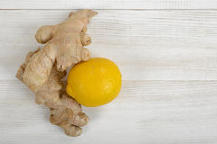 Lemon and ginger on wooden surface with copy space in top view. Stock Photo