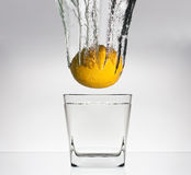 Lemon in glas with water stock image