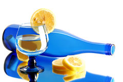 Lemon, glass and bottle. Blue bottle and glass with lemon isolated on white background Stock Images