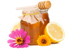 Lemon and glass of honey Royalty Free Stock Image
