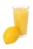 Lemon and glass of juice Stock Photos