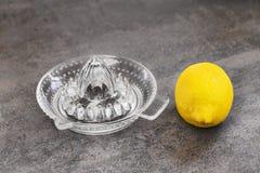 Lemon and a glass juicer Stock Image