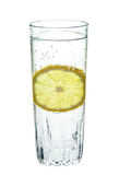 Lemon, in a glass of sparkling water, Royalty Free Stock Photos