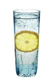 Lemon, in a glass of sparkling water, Stock Image