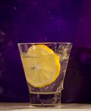 Lemon in glass after splash Royalty Free Stock Photography