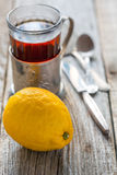 Lemon and glass of tea. Royalty Free Stock Images