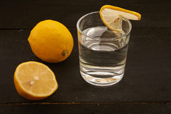 lemon and a glass of water royalty free stock images