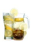 Lemon in glass on white nine Royalty Free Stock Images