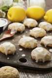 Lemon glaze cookies. On the wooden table stock photos