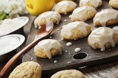 Lemon glaze cookies. On the wooden table stock images