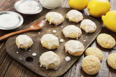 Lemon glaze cookies. On the wooden table stock photography