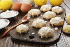 Lemon glaze cookies. On the wooden table Stock Photo