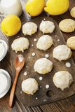 Lemon glaze cookies. On the wooden table stock photo