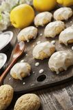 Lemon glaze cookies. On the wooden table royalty free stock photos