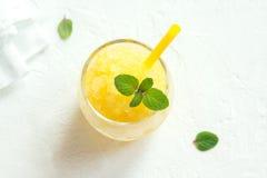 Lemon Granita. Lemon Frozen Granita Slush Drink on white table. Homemade Italian Granita Dessert, refreshing summer Slush Drink stock photos