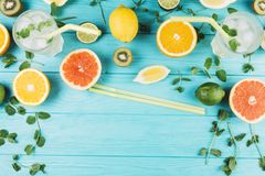 Lemon and grapefruit on light blue boards royalty free stock photography