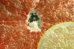 Lemon and grapefruit submerged Stock Photo
