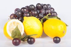 Lemon and grapes Stock Images