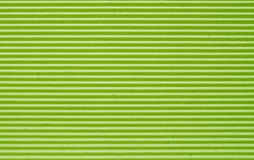 Lemon green corrugated paper background. Stock Images