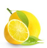 Lemon with green leaf Stock Photos