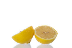 Lemon. Haft on a white background royalty free stock photos