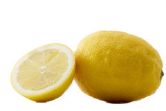 Lemon and a half. One lemon and a half on white background royalty free stock image