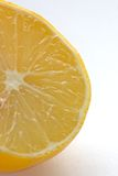Lemon half. Lemon close on white Royalty Free Stock Photos