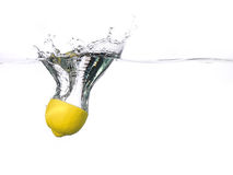 Lemon half falling into water with a splash Royalty Free Stock Images