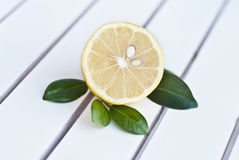 Lemon half with green leaves Royalty Free Stock Photography