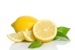 Lemon and half with leaves Stock Images