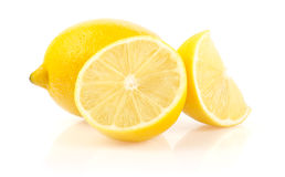 Lemon with Half and Slice on White Background Stock Photography
