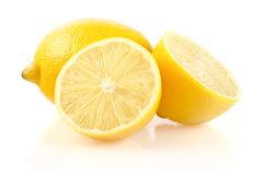 Lemon with Half on White Background Royalty Free Stock Images
