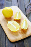 Lemon halves on chopping board Stock Photography