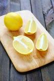 Lemon halves on chopping board Stock Photography